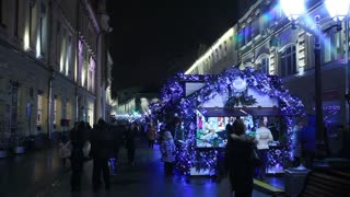 MOSCOW, RUSSIA - DECEMBER 14, 2014: The streets of the city on the eve of Christmas. Set of holiday lights, garlands, crowds and street vendors.