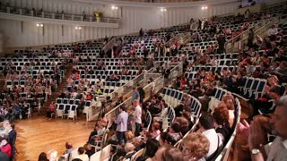 MOSCOW, RUSSIA - JUNE 28, 2015: Audience applause welcomed the Symphony orchestra at the Tchaikovsky concert hall, Moscow.