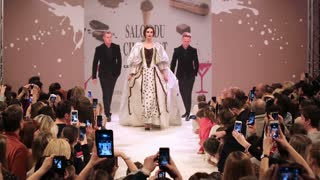 MOSCOW, RUSSIA - MARCH 07, 2015: Girls models show the audience dresses during the fashion show. Fashion show of chocolate dresses during Solon Chocolate (Salon du Chocolat) in Moscow.