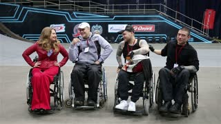 MOSCOW, RUSSIA - MARCH 13, 2015: Group of people with disabilities in wheelchairs at the stadium during a charity show MOTOTERAPIA.