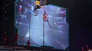 """MOSCOW, RUSSIA - MARCH 14, 2015: Big crazy moto show. Extreme Sport Motocross FMX Riders Big Jump, slow motion. International Festival of Extreme Sports """"Breakthrough 2015""""."""