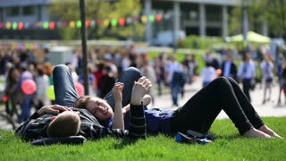 MOSCOW, RUSSIA - MAY 09,2015: Couple in love on the grass in a city Park.