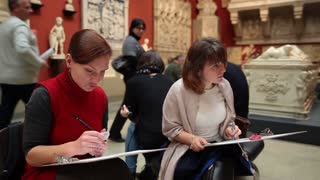 MOSCOW, RUSSIA - November 3, 2014: Visitors to draw in the Pushkin Museum of Fine Arts at the charity festival