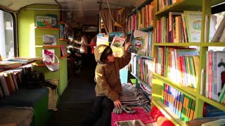 MOSCOW, RUSSIA - November 4, 2014: Children and adults choose books at the bookstore on wheels