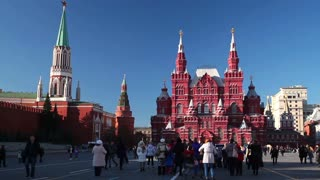 MOSCOW, RUSSIA - OCTOBER 29, 2014: Tourists walk on red square against the Kremlin and the Historical Museum in Moscow.