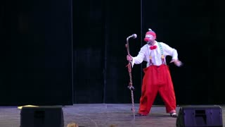 MOSCOW, RUSSIA - SEPTEMBER 12, 2015: Clown dancing on the stage. Festival of clown art Clownfest in Sokolniki Park.