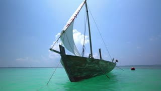 Old Wooden Boat With A White Sail In The Indian Ocean.