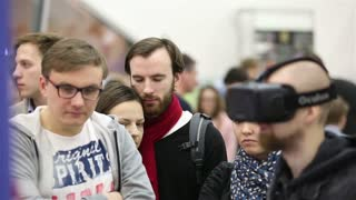 OSCOW, RUSSIA - MARCH 29, 2015: Virtual reality game. Young man uses a head mounted display Oculus Rift. Exhibition of modern technologies TechTrends Expo.