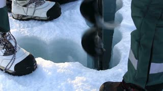 Polar scientists drilled a hole in the ice to take samples of sea water at the North Pole.
