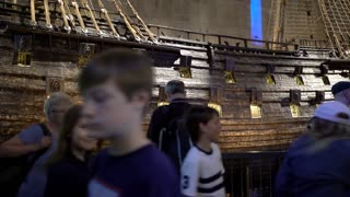 STOCKHOLM, SWEDEN - MAY 01, 2016: Tourists to the interior of the Maritime Vasa Museum in Stockholm. Dolly shot.