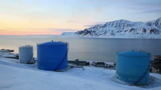 Tanks for the storage of oil. Storage facility on the shores of the Arctic Ocean, Svalbard.