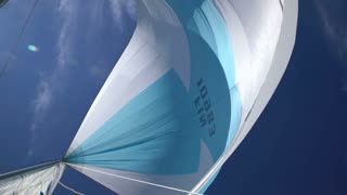 The wind blew up spinnaker at the bow of yacht