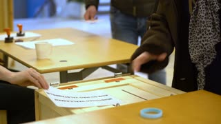 HELSINKI, FINLAND - 09 APRIL, 2017: Person casting a vote into the ballot box during municipal elections