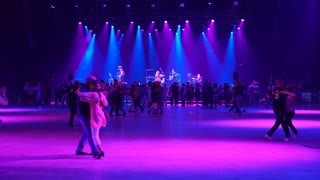 HELSINKI, FINLAND - AUGUST 19, 2017: A lot of couples are dancing tango. Vintage dance in a disco with live musical accompaniment. Festival for all lovers of dance Let's Dance Helsinki