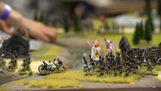 HELSINKI, FINLAND - JULY 29, 2017: Young people play table miniature military role-playing game. Exhibition ROPECON is show tabletop, live-action and card role-playing games, miniature war and board