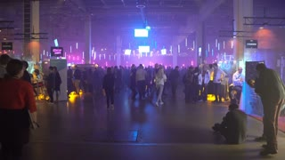 HELSINKI, FINLAND - NOVEMBER 30, 2017: A lot of investors, businessmen and students on the startup forum in a huge hall. Startup and tech event Slush in Messukeskus Expo center. Non-profit event for