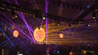 HELSINKI, FINLAND - NOVEMBER 30, 2017: The laser show opens the speaker's speech in the huge hall. Startup and tech event Slush in Messukeskus Expo center. Non-profit event for entrepreneurs