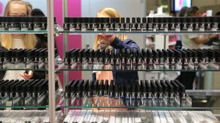 HELSINKI, FINLAND - OCTOBER 20, 2017: A lot of women testing and buying cosmetics in a beauty store. Fair I LOVE ME - Beauty, Health, Naturally, Fashion and Jewel&Watch at Messukeskus Expo