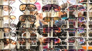 HELSINKI, FINLAND - OCTOBER 20, 2017: Buyers choosing new optical glasses in optician shop. Fair I LOVE ME - Beauty, Health, Naturally, Fashion and Jewel&Watch at Messukeskus Expo Centre
