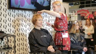 HELSINKI, FINLAND - OCTOBER 20, 2017: Hair Stylist works with a model. Hair dyeing. Fair I LOVE ME - Beauty, Health, Naturally, Fashion at Messukeskus Expo Centre