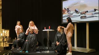 HELSINKI, FINLAND - OCTOBER 20, 2017: Hair Stylist works with a model. Presentation of the product Remington. Fair I LOVE ME - Beauty, Health, Naturally, Fashion at Messukeskus Expo Centre