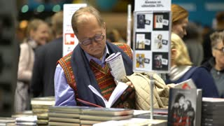 HELSINKI, FINLAND - OCTOBER 29, 2017: Many lovers of reading, buyers, publishers and books at the big book fair. A huge book fair at the Expocentre Messukeskus