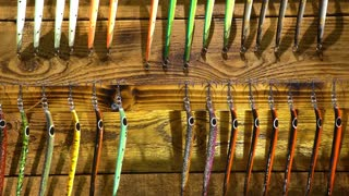 Triple hooks and colorful fishing lures in the sporting goods store. Close up