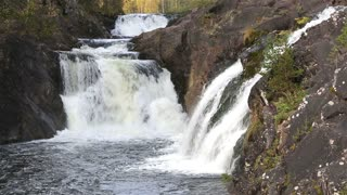 Waterfall Kivach in the protected forest of Northern Europe.