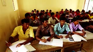 A high school teacher giving a lecture to the class-India