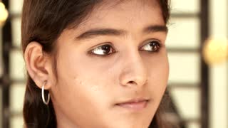 A Indian Young Girl Looks At The Camera