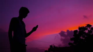 The man looking for a mobile network at Silhouette shot