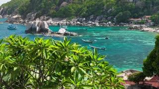 Amaing Tanote Bay with his beautiffull coral reef und huge granite blocks and longtail boat at anchor, Koh Tao, Thailand
