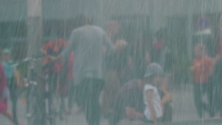 People in the City near Fountain Flow Close-Up, rain effect