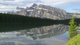 Close shot of Mount Rundle reflected in Two Jack Lake, Banff, Alberta, Canada