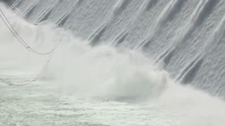 Close up shot of the spillway and power lines on the Grand Coulee Hydroelectric Dam, Washington, USA cu 01.mov