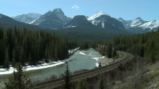 Freight train and Bow River at 'Morant's Curve
