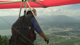 Hang Glider launches off the ramp high above the valley
