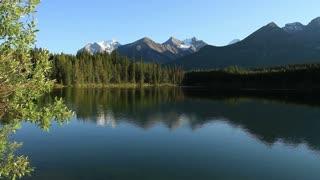 Mountains reflected in Herbert Lake, Banff, Alberta, Canada