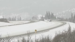 Semi trailer trucks on a snowy winter highway 2