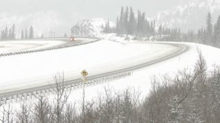 Semi trailer trucks on a snowy winter highway