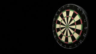 Single dart hits the bull's eye of a dartboard