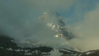 The Peak of Mount Assiniboine with time lapse of clouds, Canadian Rockies