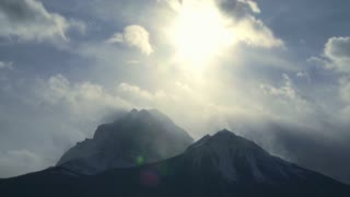 Time lapse of clouds and sun over Mount Temple in the Canadian Rockies, Banff, Alberta, Canada