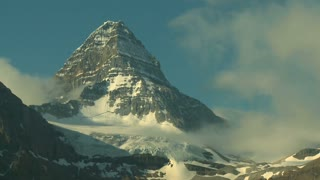 Time Lapse of Mount Assiniboine sunrise with morning light and wispy clouds