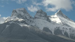 Time Lapse of The Three Sisters mountain group with fresh snow, Canadian Rockies