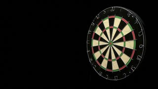 Wide shot three darts last one hits the target