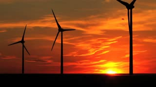 Wind turbines and the brilliant sky of a setting sun, Alberta, Canada