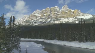 Winter scene of Castle Mountain and Bow River near Banff, Alberta, Canada