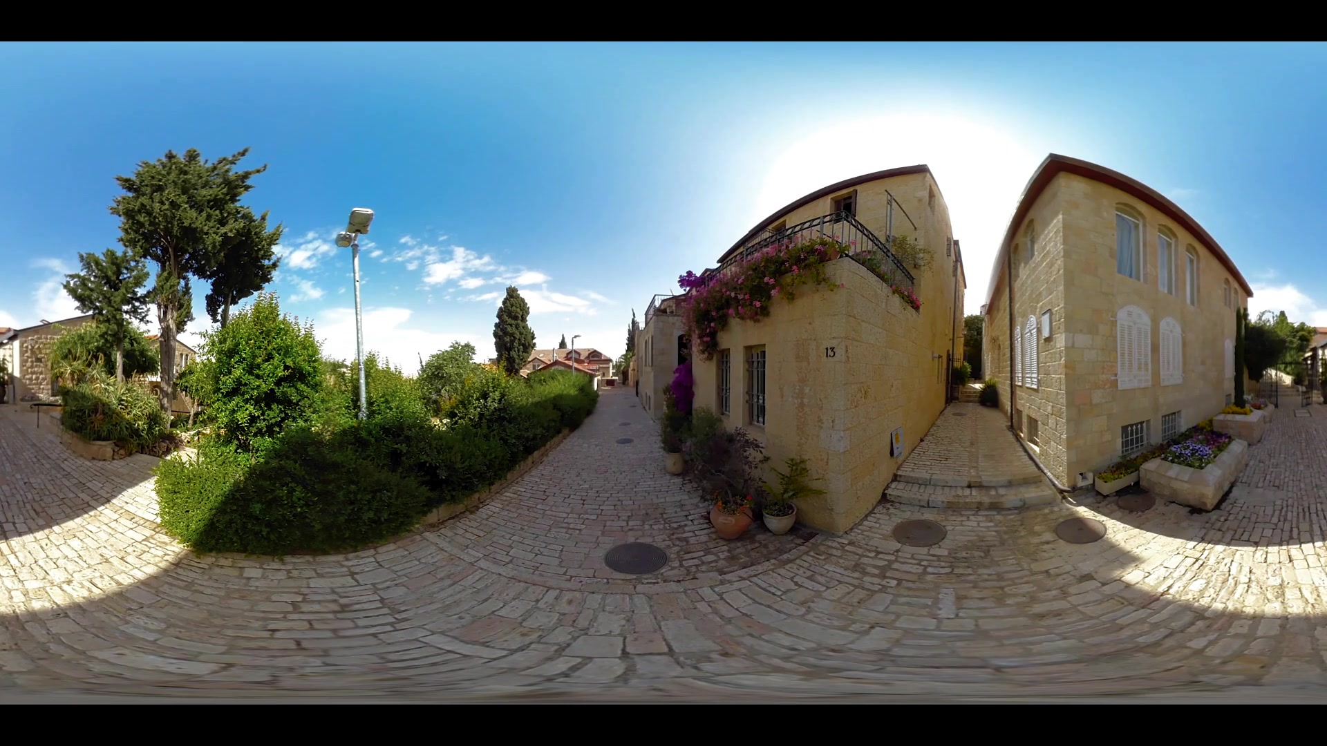 360VR video of street and houses of Mishkenot Shaananim neighborhood in Jerusalem, Israel. It was the first Jewish neighborhood built outside the walls of the Old City of Jerusalem in 1860.