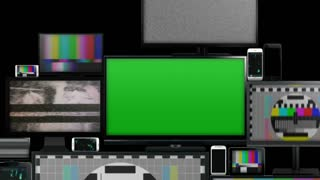 Many different types of screens. TVs, computer monitors, smartphones and tablets. They laid on each other in a pile isolated on a white background. They are all with no signal. With alpha and zoom out.